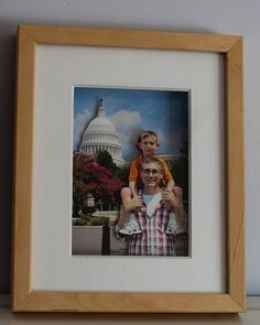 Pop Out Picture. You just need multiple copies of the same photograph, some scissors, adhesive dots, and a shadowbox frame to make this cute gift.