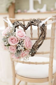 wedding chair decorations with pink roses and heart shaped wreath