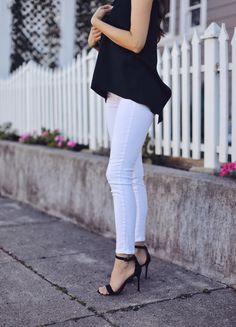 Fashion and lifestyle blogger Adelina Perrin of The Charming Olive wearing Stitch Fix Black Top and White Jeans