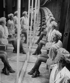© Allan Grant, 1949, Shelley Winters in a booth with mirrors. S)