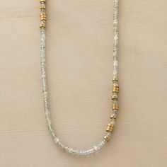 """TOUCHES OF BRASS NECKLACE--In this brass and aquamarine necklace, segments of matte brass disks protrude just enough to make a statement amid aquamarine rondelles. 14kt goldfilled lobster clasp. Sundance exclusive handmade in USA. 16"""" to 17""""L."""