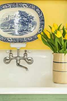 """""""Why go and buy something new when you can make something old beautiful again?"""" The owner of this remodeled cottage kitchen used a 1930s cast-iron sink and a 1910 Crane faucet."""