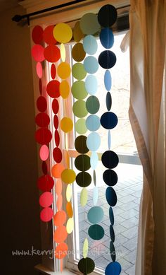 Rainbow garland tutorial (cut the circles out of cardstock with a Big Shot and sew them together)