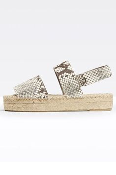 Walk Everywhere? You'll Love This Summer Shoe Trend #refinery29  http://www.refinery29.com/summer-espadrilles#slide-5  SandalsSnake print goes subtle when paired with a natural sole.