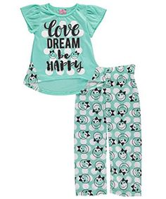 Sweeten her bedtime look with this comfy pajama set from Sweet n Sassy!    Sweet n Sassy 2-piece pajamas  Poly jersey shirt with hi-low hem and contrast side panels (100% polyester)  Printed poly pants with elastic waistband (100% polyester)  Flame resistant  Machine wash cold  Imported