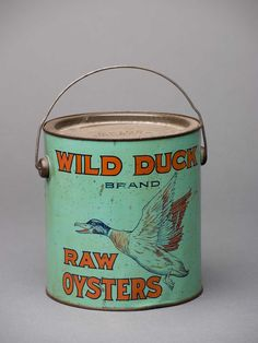 """In the late 19th century, the Chesapeake produced more oysters than any other region in the world. The oyster-packing industry was centered in Baltimore, and Roy E. Roberts was just one among scores of oyster packers in the city. ... Although Robert would later market most of his oysters under the """"Maryland Beauty"""" brand, he briefly used the """"Wild Duck"""" brand- making it among the rarest, most valuable, and most collectible oyster cans in the world. © Chesapeake Bay Maritime Museum."""