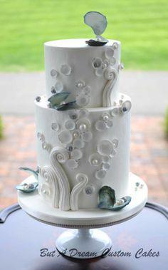 Modern beach themed cake by Elisabeth Palatiello - http://cakesdecor.com/cakes/279110-modern-beach-themed-cake