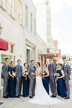 groom and groomsmen gray suit navy tie long navy mix matched bridesmaids dresses bride unforgettable floral spring wedding photo college station texas dreamy elk photography and design Grey Tux Wedding, Wedding Attire, Wedding Men, Wedding Suits, Wedding Ideas, Navy Bridesmaid Dresses, Bridesmaids And Groomsmen, Groomsmen Attire Navy, Groomsmen Trends