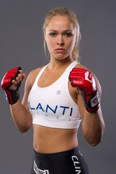 Ronda Rousey is the first female UFC champ and highest paid female UFC fighter -- a milestone in athletics and sponsorships for female MMA.
