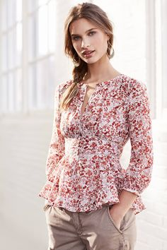 I love the fit and style of this blouse. Not sure about the pattern but it looks like a great style for a breastfeeding mama. Amelie Blouse - anthropologie.com