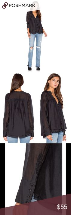 """Free People Babydoll Blouse Mandarin collar. Long sleeves with quadruple barrel cuffs. Front button closure. Babydoll silhouette. Semi-sheer construction. Tonal lining with exposed ruffle trim. Approx. 25"""" length. Shell: 70% cotton, 30% silk. Lining: 100% viscose. Machine wash cold. Fit: this style fits true to size. Color: black. No trades. Reasonable offers welcome. Free People Tops Blouses"""