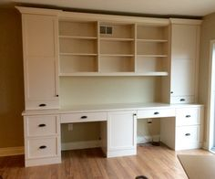 Custom built in - his and her desk with printer hidden in middle base unit.