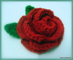 Blooming rose. One of those roll-and-sew kind, and I've never been good at that but this is very pretty.  js