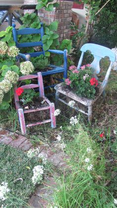Old chairs become garden art. Now, I'm on the lookout at all thrift stores and garage sales