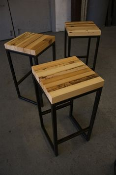 Steel and pieces of reclaimed wood bar stools. Love the lines and simplicity.