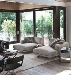 Gray chaise lounges--image via Click Interiors #zincdoor #modern #gray #decor #homedecor #interiordesign #livingroom