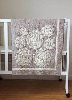 Love this quilt!! And the actual quilting goes so well with the doilies. How cute would this be with some of her ombre fabric?!: