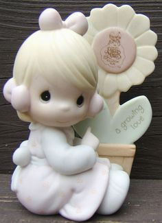 Check out Enesco Precious Moments A Growing Love Girl Flower Collector Club figurine 1986  http://www.ebay.com/itm/Enesco-Precious-Moments-Growing-Love-Girl-Flower-Collector-Club-figurine-1986-/151101942822?roken=cUgayN&soutkn=KjW9P3 via @eBay