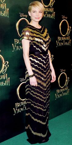 Michelle Williams wearing a deco black-and-gold Jason Wu column.
