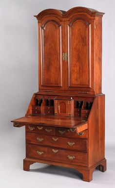"""Pennsylvania Queen Anne cherry secretary, ca. 1745, the double dome cornice over 2 raised panel doors, enclosing a fully fitted interior, resting on a base with slant lid and pagoda interior, above a case with 2 candle drawers and 5 drawers supported by straight bracket feet, 93"""" h., 39 1/2"""" w."""