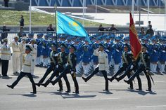 The color guard of the Republican Guard of Kazakhstan trooping the Kazakh national flag and the Victory Banner at the 2015 Kazakh Armed Forces Day Parade in Astana, Kazakhstan.