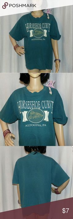 Horseshoe Curve Railroad T-Shirt Altoona , PA Really nice souvenir T-Shirt for the railraod fan. It is a nice  aqua color. Item weighs in at 11 oz. So  with the magic of Poshmark bundle up and save on shipping 5lb sends for one price! Buy more and save. This is in very good Vintage Condition Eagle Tops Tees - Short Sleeve