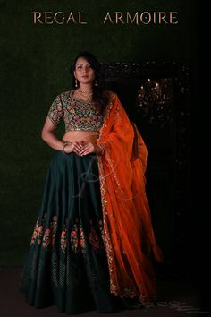 The Shoot for which most of you have been waiting is here! Beautiful bottle green color lehenga and blouse with orange color net dupatta. Lehenga and blouse with floret lata design hand embroidery thread work.  17 March 2018