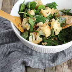 Warm Cauliflower Spinach Salad With Pancetta and Golden Raisins - it's the perfect winter salad... healthy, hearty, and full of flavor!