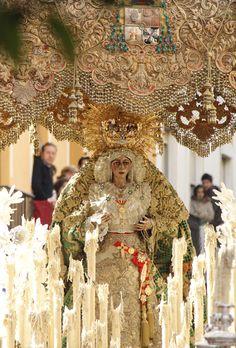 Igual que ayer permanece, /  sale poco de su casa, /   mas cuando sale traspasa /   la muralla y la florece. /   Tan adornada, parece /  una novia en su balcón. /  Su cara y sus manos son /  del pueblo los aledaños. /  Siempre alivia desengaños /   esta moza de San Gil /  que dicen que, por abril /  cumple diecinueve años. San Gil, Candle In The Wind, Palm Sunday, Virgo, Folk Art, Catholic, Doll, Inspiration, Saints