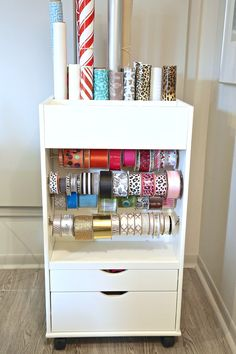 Creative Christmas Storage Ideas and Products Gift Wrap Cart that stores over 50 plus spools of ribbon and 25 rolls of gift wrap. Gift Wrap Storage, Ribbon Storage, Storage Ideas, Home Organisation, Craft Organization, Christmas Storage, Small Space Storage, Organizing Your Home, Organizing Ideas