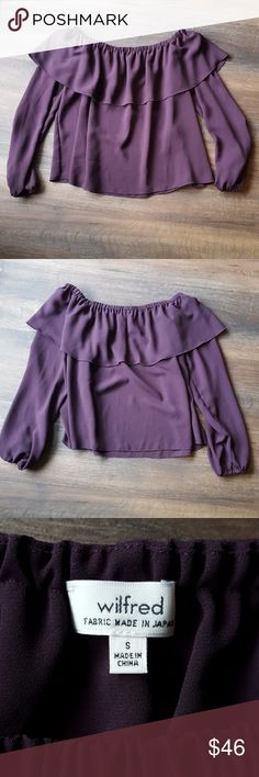 Wilfred off the shoulder purple blouse In excellent condition! The model is wearing the same blouse BUT in a different color, just including it so you can better see the fit. It is a deep purple color (pics show it in two different lighting settings, I would say it is more like the first picture). Aritzia Tops Blouses