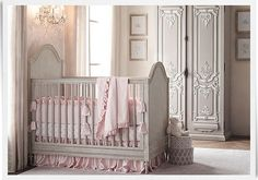Traditional Nursery with Wall sconce, Built-in bookshelf, 19th C. Rococo Armoire, bellina grand panel crib, Hardwood floors
