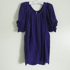 Purple Short Sleeve Blouse Great for any day!!! Loose blouse with ruffles at the end of sleeves. Button at the top of the collar on the back. Worn a few times. Great condition Express Tops Blouses