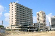 The Varosha quarter of Famagusta in Northern Cyprus has been abandoned since the 1974 Turkish Invasion of Cyprus, and is now known as the Ghost City.