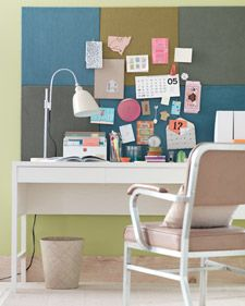 Create a colorful bulletin board with a staple gun and carpet squares.