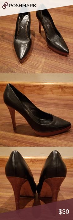 """Boutique 58 Black Pump w/ Wood Heel and Platform A great pair of Boutique 58 black heels in excellent condition. I took a photo of the 2 scuff marks (one on each shoe) that can easily be covered. The deep chestnut wood heel is 4"""" and platform 1/2"""". I love the contrast between the wood and black leather. They are marked inside a 5.5 so I listed them as a 5.5,  but I really think they would fit a 6 or 6.5. Bummed they were too big, but they are a great looking shoe!👠👍 Boutique 58 Shoes Heels"""