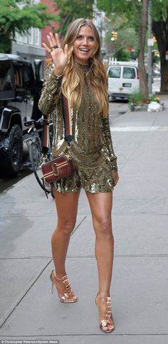 Timeless beauty: Heidi looked amazing in the gold mini dress with matching gold heels ...