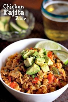 This Chicken Fajita Rice is perfect for your Cinco De Mayo dinner! Chicken, peppers, onions and avocado mixed in with seasoned rice.