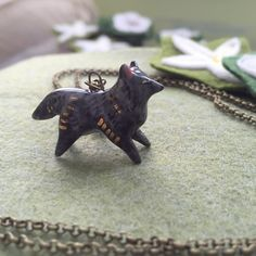 I love my little dark wolf from @smallwildshop #handmade #buyhandmade #ceramic #wolf #womeninbusiness #art #jewelry by alyparrott
