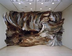 Abstract: How do you show chaos in nature? This wood sculpture seems to attempt to represent that in an abstract installation.   Henrique Oliveira wood installation, sculpture Brazil