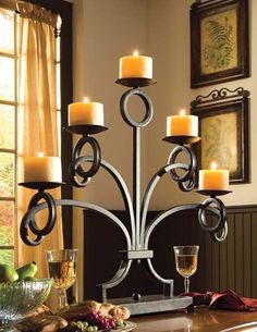 I LOVE this candle holder and I love it with the yellow candles. Considering making my room yellow and black! Thoughts?