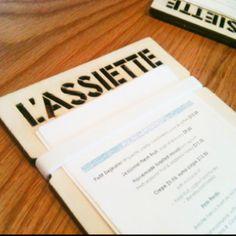 Great menus at L'assiette - love the laser-cut heading!