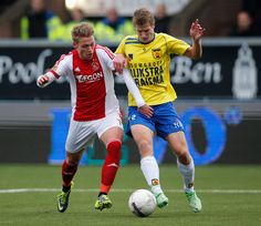 Viktor Fischer Photos Photos - Wout Droste of Cambuur and Viktor Fischer of Ajax battle for the ball during the Eredivisie match between SC Cambuur and Ajax Amsterdam held at Cambuur Stadion on December 15, 2013 in Leeuwarden, Netherlands. - SC Cambuur v Ajax Amsterdam - Eredivisie