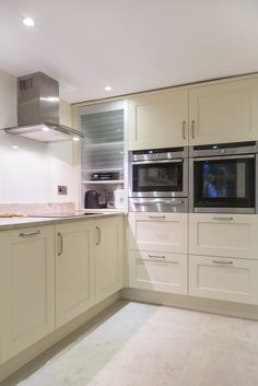 Farrow and Ball hand-painted kitchen with granite tops and glass tambour door Simple Kitchen Design, Kitchen Pantry Design, Kitchen Corner, Home Decor Kitchen, Kitchen Furniture, Kitchen Cabinet Doors, Kitchen Cabinets, White House Interior, Bespoke Kitchens