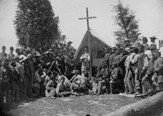 Chaplain conducting mass for the 69th New York State Militia encamped at Fort Corcoran Washington D.C. 1861. Photographed by Mathew B. Brady. 165-C-100. National Archives Identifier: 533114.
