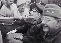 A Frenchman gives a light to Winston Churchill 1944