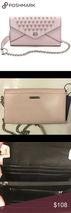 """REBECCA MINKOFF WALLET ON A CHAIN ❤FIRM PRICE ❤ NWT Rebecca Minkoff wallet on a chain with studs. 12 card slots. Middle zipper compartment. Silver tone hardware details. Removable leather and chain cross body strap. Measurements: 8 1/4"""" L 5""""H. Retail $228. Rebecca Minkoff Bags Crossbody Bags"""