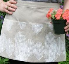 If you're looking for free apron patterns to sew, this Easy Gardening Apron is a great craft to keep your gloves, seed packets and gardening tools right on hand while you work in the garden. Learning how to make an apron is very simple with this free sewing tutorial, even for beginners. Plus, it can be finished in one day!