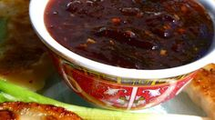 Plum jam is cooked with vinegar, brown sugar, garlic and spices to create a sauce that you can serve hot or chilled, with egg rolls, pork or chicken.