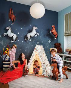 Love the horse balloons! Patricia Herrera Lansing // photo by Christopher Sturman from Haper's Bazaar